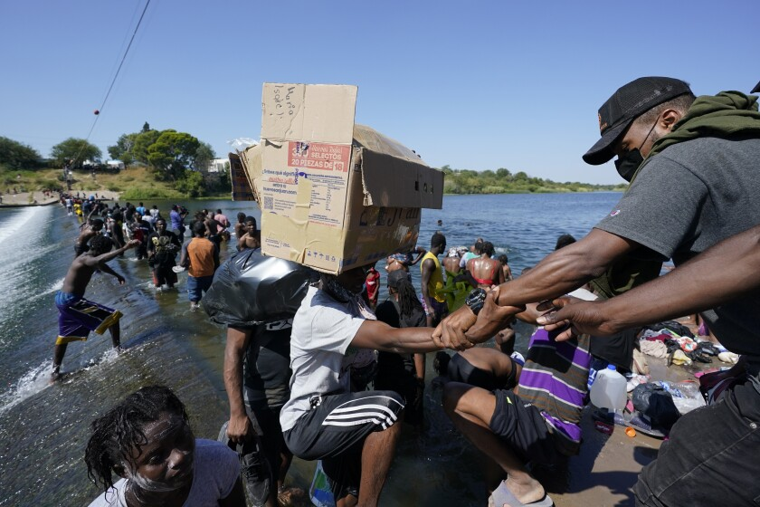 Haitian migrants use a dam to cross to and from the United States from Mexico.