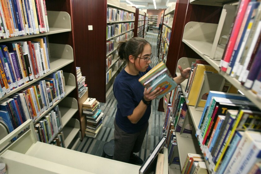 A library page shelves books at the Sun City Library in 2010. The Friends of the Sun City Library, which helps support the library, is now offering business memberships for $50 a year. The Californian file photo