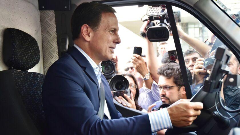 SAO PAULO, BRAZIL - JANUARY 10: Mayor of Sao Paulo Joao Doria Jr. poses prior a ceremony to deliver
