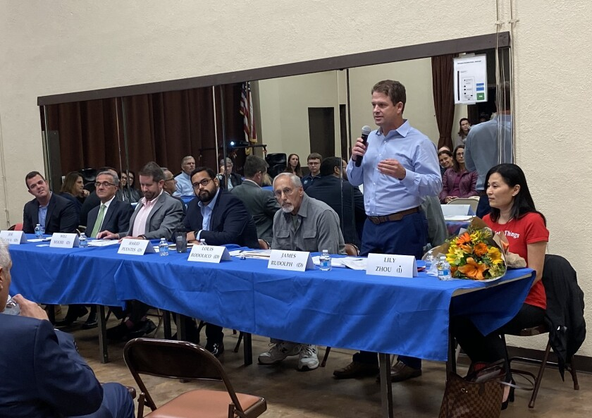Seven candidates for City Council District 1 — Aaron Brennan, Joe LaCava, Will Moore, Harid Puentes, Louis Rodolico, James Rudolph and Lily Zhou — state their cases at the Nov. 14 La Jolla Town Council meeting.