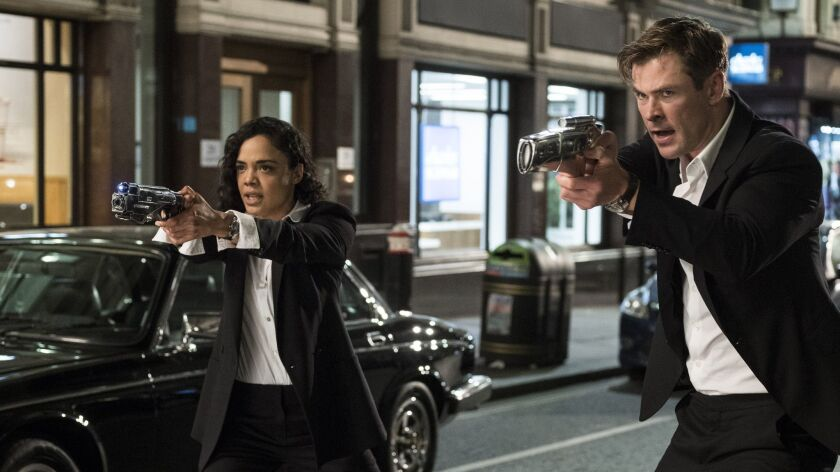 This image released by Sony Pictures shows Tessa Thompson and Chris Hemsworth in a scene from Columb