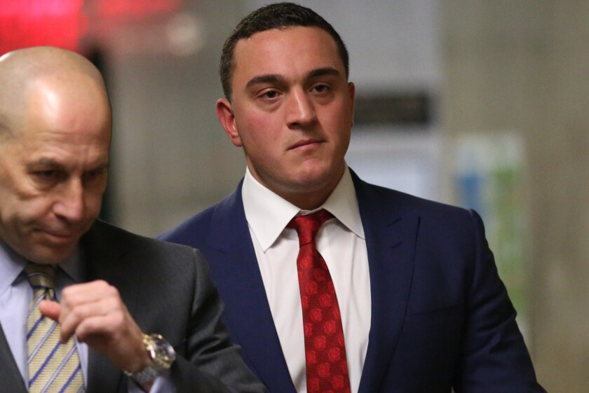 """Louis Ruggiero in the hallway at Manhattan Criminal Court on Tuesday. Ruggiero, the son of """"Good Day New York"""" anchor Rosanna Scotto, testified today as the prosecution's star witness in the murder trial of James Rackover."""