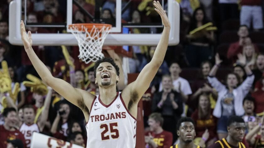 USC forward Bennie Boatwright celebrates after making a three-point shot in the closing seconds to beat Arizona State 69-67 at the Galen Center on Saturday.
