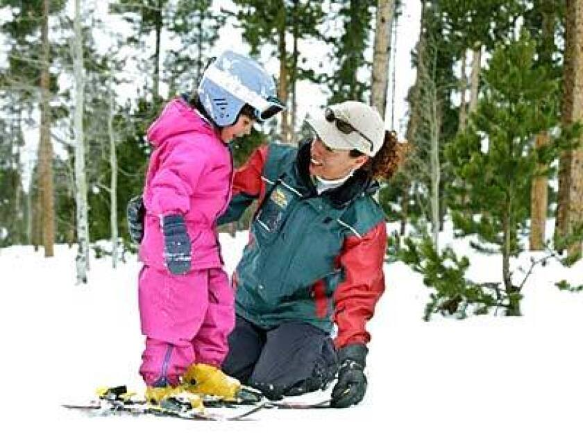 A SolVista staffer tutors a participant in the ski-school children's program. For adults, there's the Guaranteed Start to Ski or Snowboard program, which promises to have beginners up and skiing in one day.