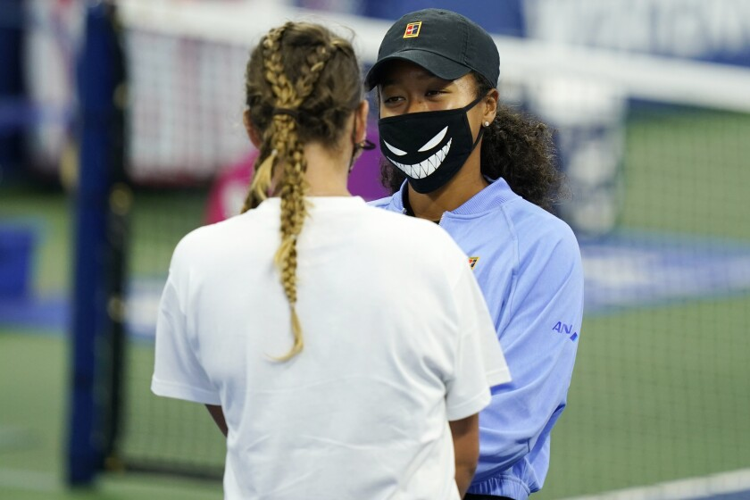 Naomi Osaka talks with Victoria Azarenka before the trophy ceremony Saturday on  Aug. 29, 2020, in New York.