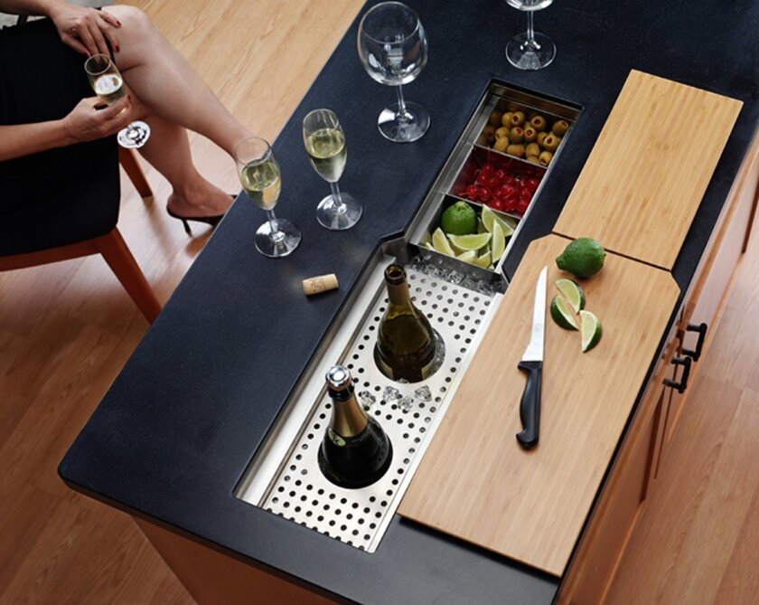 Lenova knows that parties always end up in the kitchen. The company's new Entertainer Sink has built-in condiment trays, bottle holders and cutting boards.