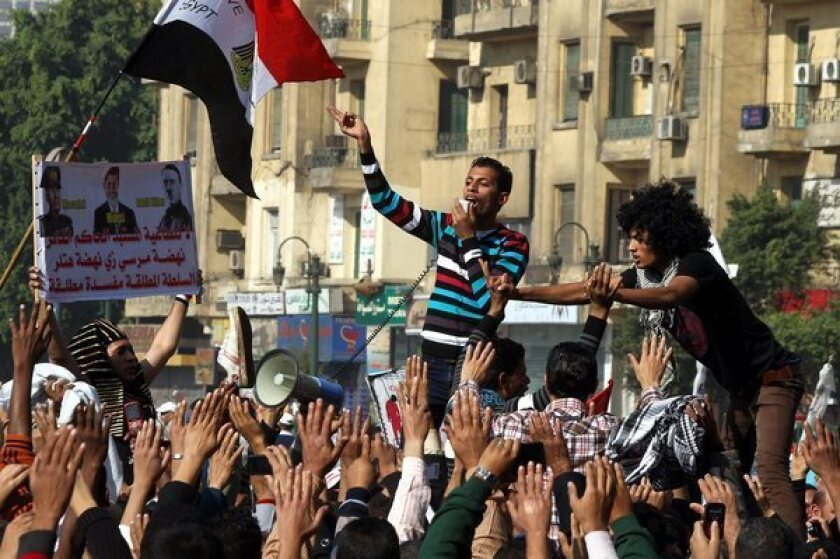Street protests follow approval of Egypt's draft constitution