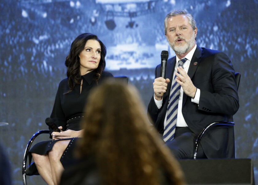 Jerry Falwell Jr., with wife Becki, speaks at a 2018 town hall meeting at Liberty University in Lynchburg, Va.