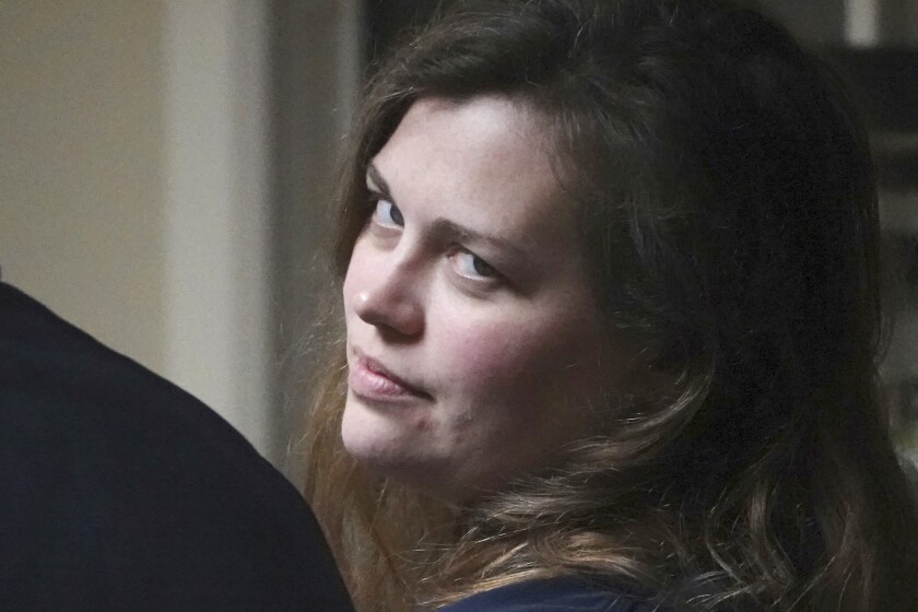 Hannah Roemhild, who is accused of driving through checkpoints outside President Donald Trump's Florida home Mar-a-Lago, looks back during her initial appearance hearing, Monday, Feb. 3, 2020, West Palm Beach, Fla. (Joe Cavaretta/South Florida Sun-Sentinel via AP)