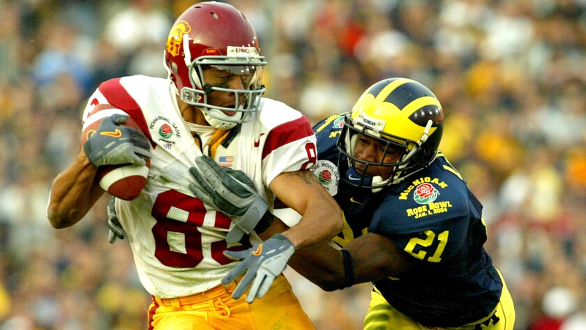 Keary Colbert makes a one-handed catch against Michigan defensive back Jeremy LeSueur to score a touchdown in the Rose Bowl on Jan. 1, 2004.