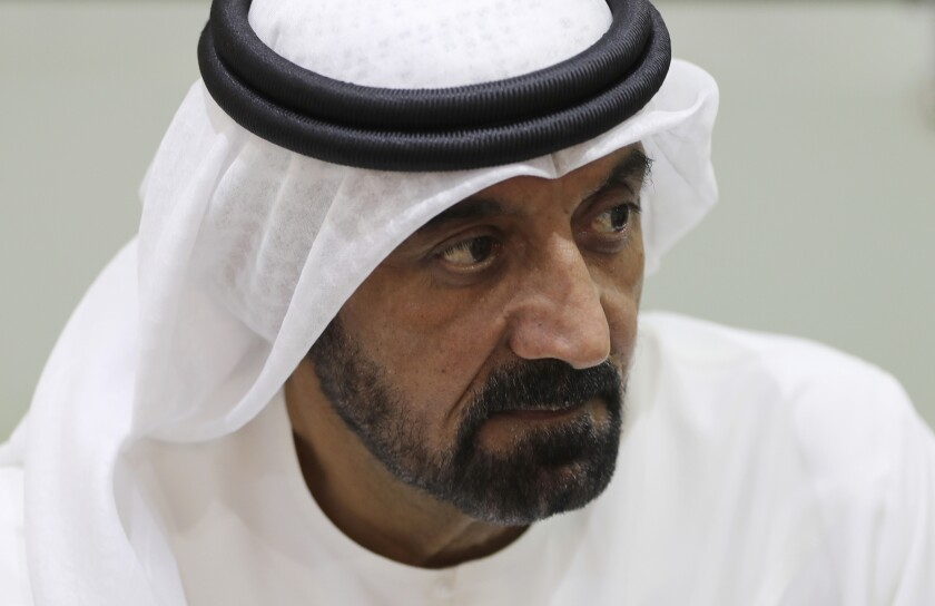 Sheikh Ahmed bin Saeed Al Maktoum, president of the Department of Civil Aviation, CEO and chairman of The Emirates Group speaks with journalists at the Arabian Travel Market exhibition in Dubai, United Arab Emirates, Monday, May 17, 2021. The Middle East's largest airlines saw its passenger levels plummet by 70% last year and furloughed more than 25% of its staff due to the coronavirus pandemic, Al Maktoum said Monday. (AP Photo/Kamran Jebreili)