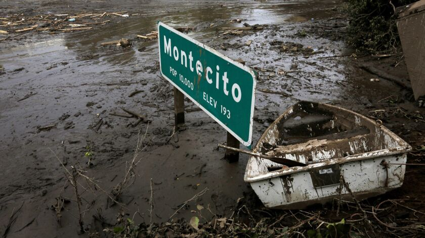 Less than a year after mud and debris flows devastated Montecito, officials are warning that recent wildfires have increased the risk of flooding. Here, mud and debris obscures Highway 101 in Montecito in January.