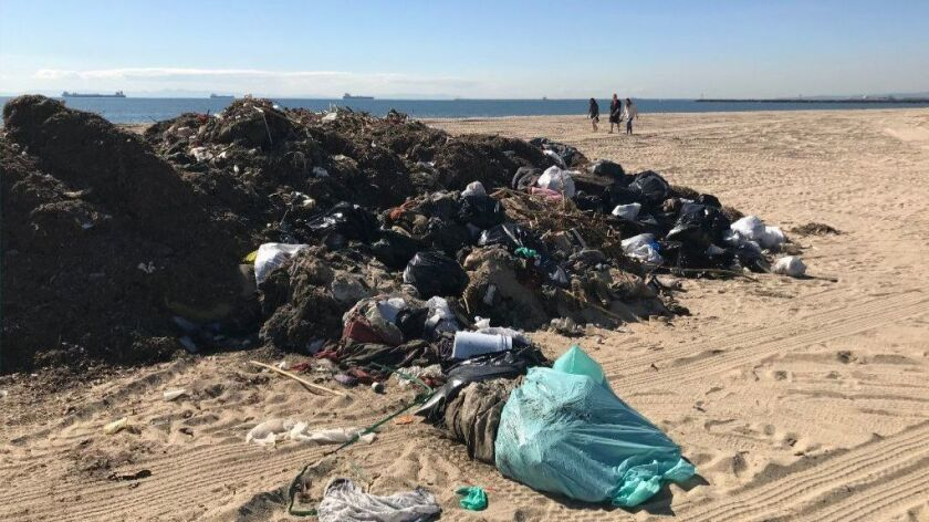 Several days of rain have led to piles of trash washing up on many of Southern California's beaches, including this heap in Seal Beach on Feb. 7.