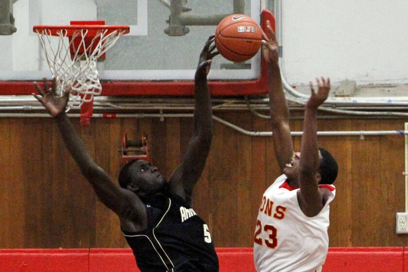Army-Navy's Cheikh N'diaye grabs a rebound over Cathedral Catholic's J.J. Sellner. N'diaye finished with 22 points, 25 rebounds and 10 blocked shots.