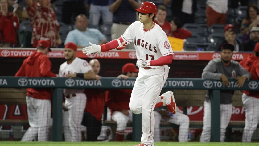 Los Angeles Angels' Shohei Ohtani, of Japan, celebrates after his home run against the Texas Rangers