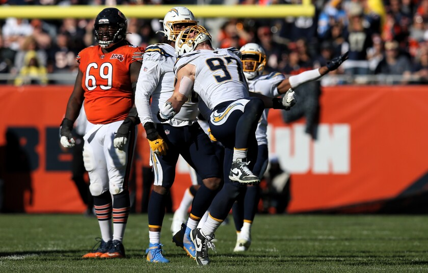 Chargers defensive end Joey Bosa celebrates after sacking Chicago Bears quarterback Mitchell Trubisky during the Chargers' 17-16 win Sunday.