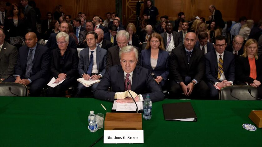 Former Wells Fargo CEO John Stumpf, shown preparing to testify in Washington last year, will have to give up another $28 million in back pay in the aftermath of an investigation into the bank's fake-account scandal.
