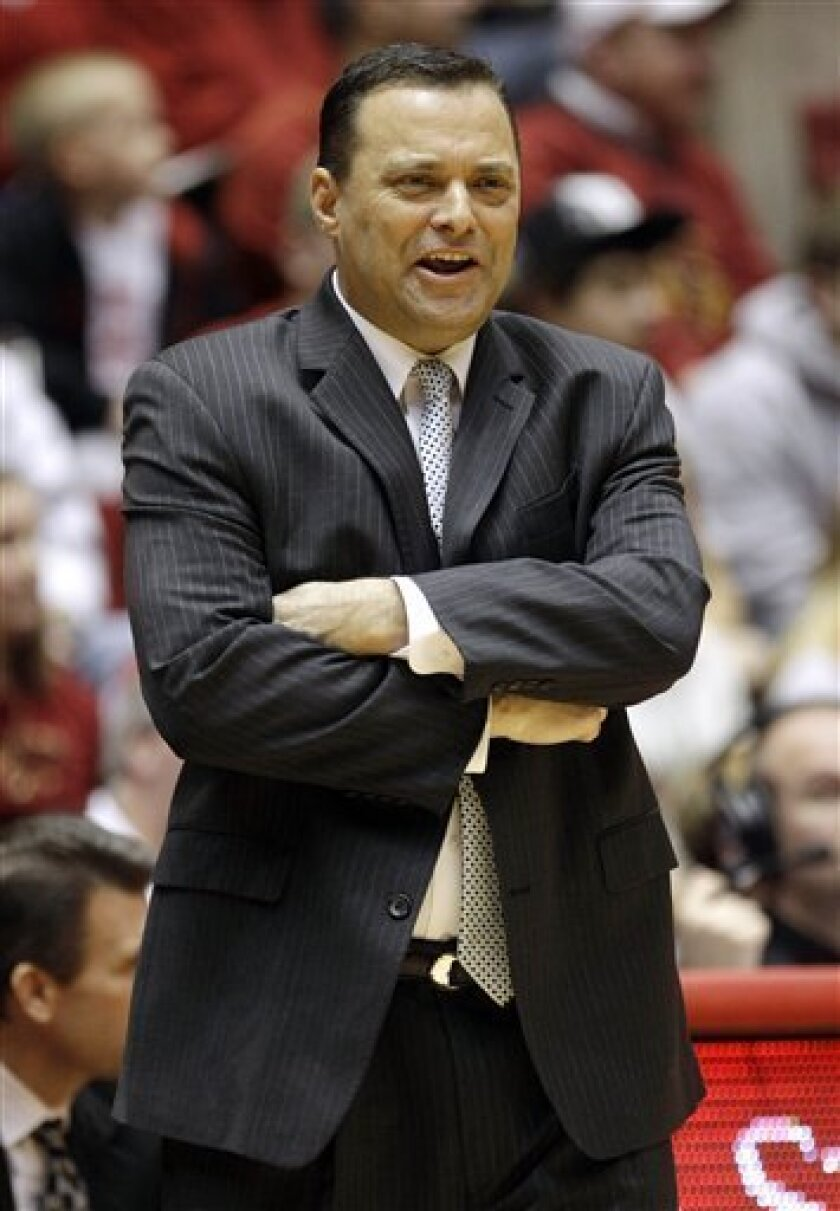 FILE - In this Feb. 22, 2012, file photo, Texas Tech coach Billy Gillispie watches during the first half of an NCAA college basketball game against Iowa State in Ames, Iowa. Gillispie has been hospitalized for an undisclosed medical issue.  Athletic department spokesman Blayne Beal said the 52-year