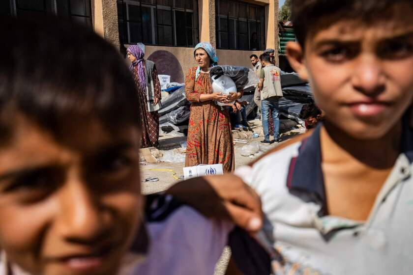 Displaced Syrians take refuge in Tal Tamr in Syria's Hasakeh province.