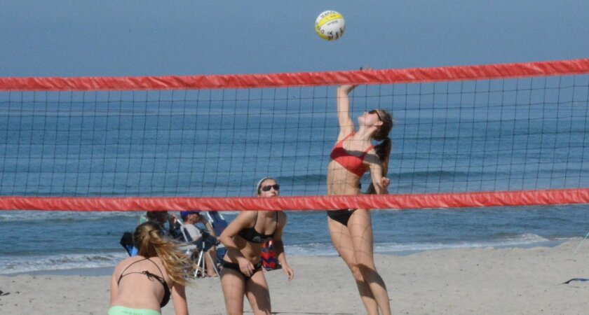 Karina Langli playing sand volleyball.