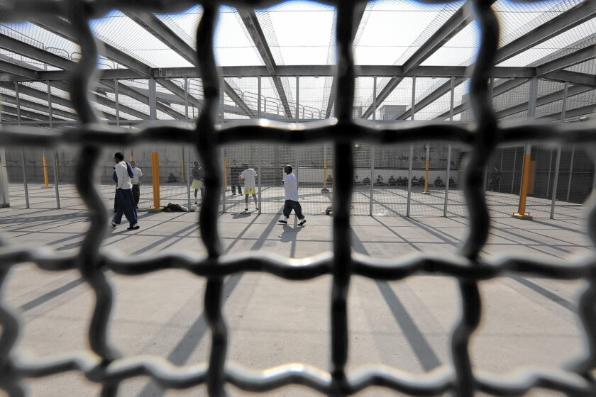 At Men's Central Jail in Los Angeles, many inmates get out of their cells for only three hours a week. Here, inmates exercise on the roof.