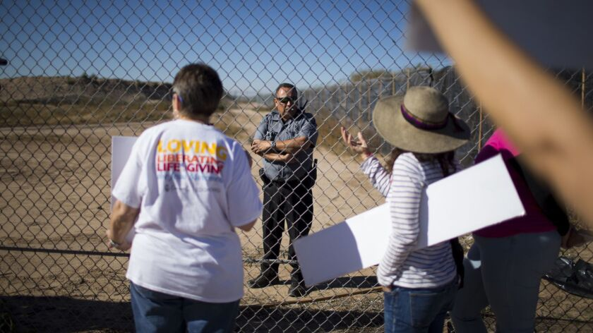 In this Nov. 15, 2018 photo provided by Ivan Pierre Aguirre, protestors talk to a guard inside the T