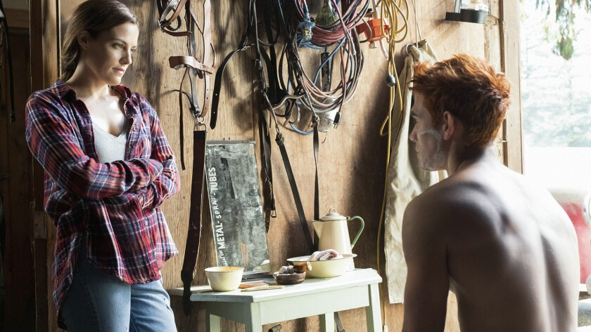 """Riley Keough as Laurie Lake and K.J. Apa as Archie Andrews in """"Riverdale"""" on the CW."""