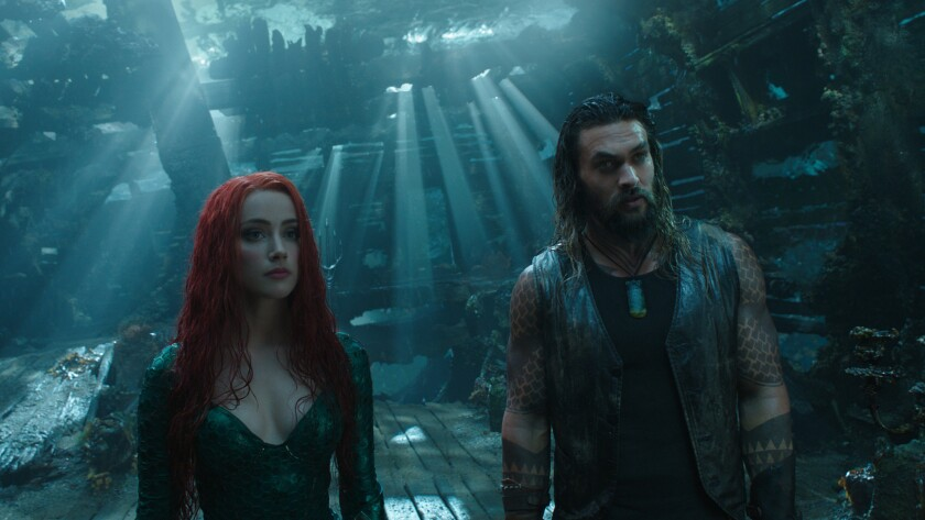 """(L-R) - AMBER HEARD as Mera and JASON MOMOA as Aquaman in Warner Bros. Pictures' action adventure """"A"""