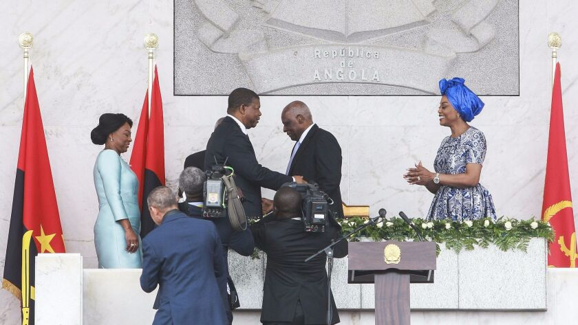 After 38 years in power, former Angolan leader Jose Eduardo Dos Santos, center right, greets incoming President Joao Lourenco, center left, during his inauguration ceremony in Luanda, Angola.