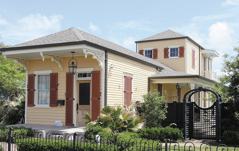 This historic shotgun house in New Orleans was remodeled after Hurricane Katrina.