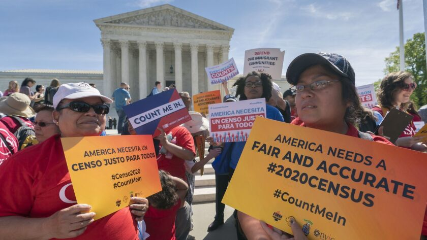 FILE - In this April 23, 2019 file photo, immigration activists rally outside the Supreme Court as t