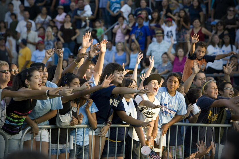 Thousands erupted upon arrival of the Little Leaguers at last night's rally. (Nelvin C. Cepeda / U-T)