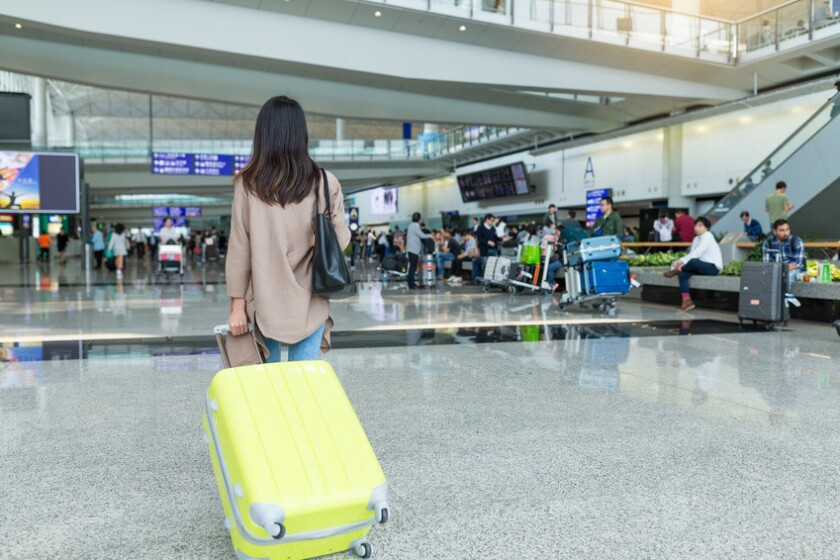 Woman travel with her luggage