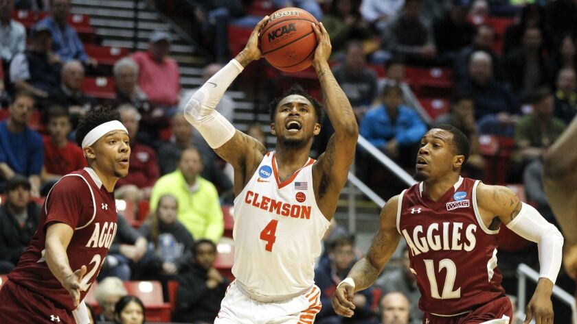 SAN DIEGO, March 16, 2018   Clemson's Shelton Mitchell shoots while pressured by New Mexico State's