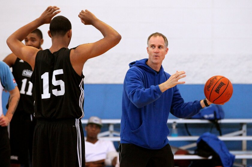 Coach Jim Saia gives instructions.