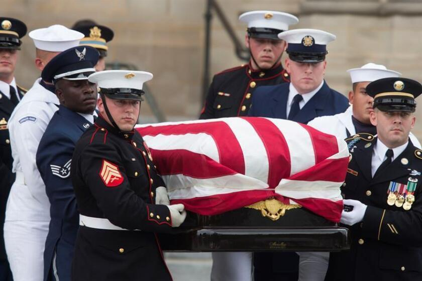 A US military honor guard team carries the flag-draped casket of John McCain out of the Washington National Cathedral at the end of a memorial service in Washington, DC, USA, 01 September 2018. EFE