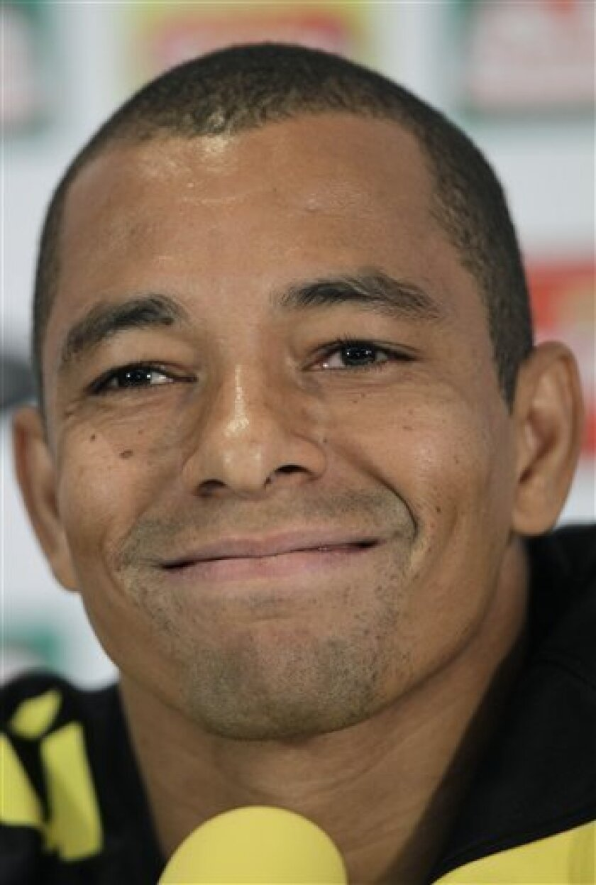 Brazil's soccer player Gilberto Silva smiles during a press conference, in Johannesburg, South Africa, Wednesday, June 9, 2010. Brazilian team is preparing for the upcoming soccer World Cup, where they will play in Group G. (AP Photo/Andre Penner)
