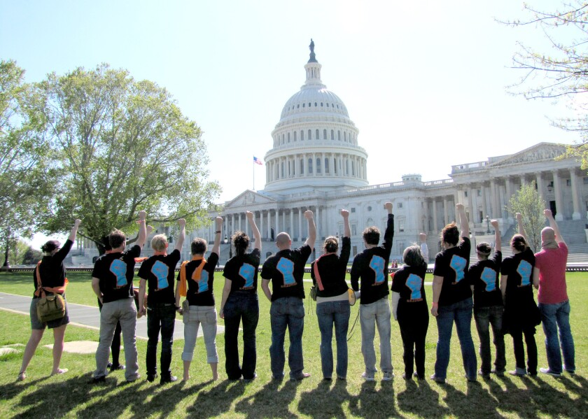 """Tim DeChristopher and other members of Peaceful Uprising -- the grassroots, nonviolent environmental action group he founded -- protest in Washington D.C., as seen in """"Bidder 70."""""""