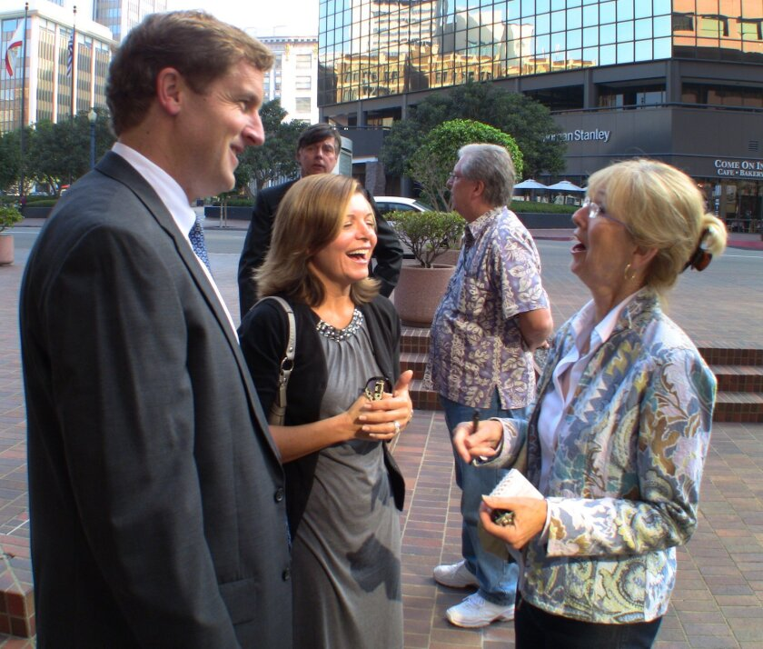 Former San Diego Councilman Michael Zucchet, left, his wife, Teresa, center, and his mother, Rozanne Mack, celebrate Wednesday outside federal court after prosecutors officially dismissed a 7-year-old political corruption case against him.