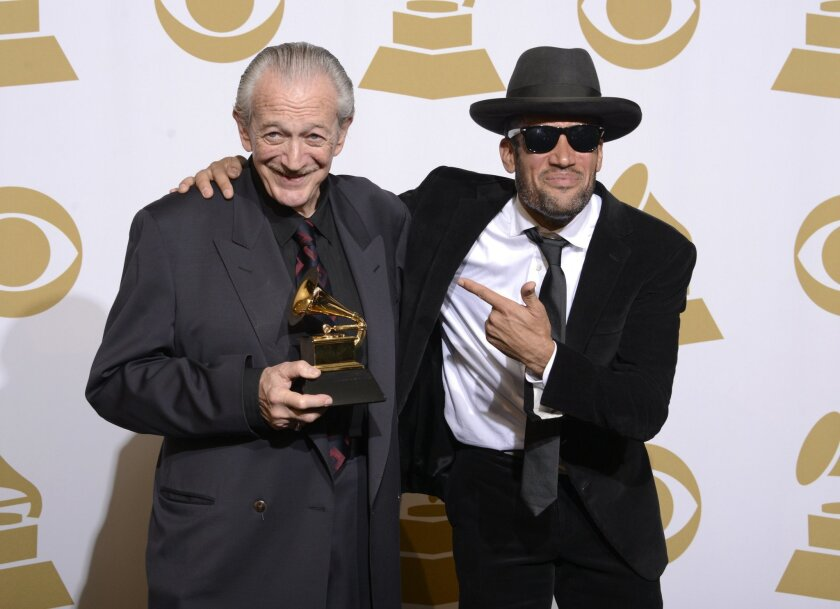 """Charlie Musselwhite, left, and Ben Harper pose with the best blues album award for """"Get Up!"""" in the press room at the 56th annual Grammy Awards at Staples Center on Sunday, Jan. 26, 2014, in Los Angeles. (Photo by Dan Steinberg/Invision/AP)"""