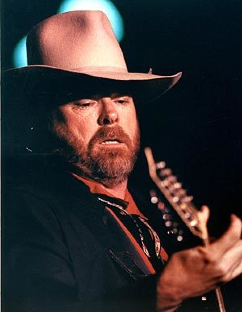 Dan Seals, seen here performing in January 1993 at the Crazy Horse in Santa Ana, died of complications from cancer. He was 61.
