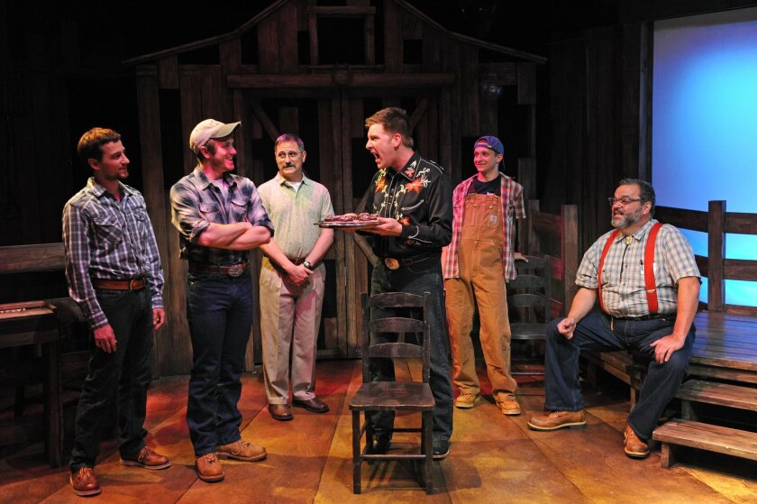 """Darrell (Tony Houck, center) defends his role as snack-bringer-in-chief to fellow chorus members (left to right) Julian (Tom Zohar), Heath (Jacob Caltrider), Wiley (John Whitley), DJ (Dylan Hoffinger) and Fuzz (Bill Nolte), in Diversionary Theatre's """"Harmony, Kansas."""""""