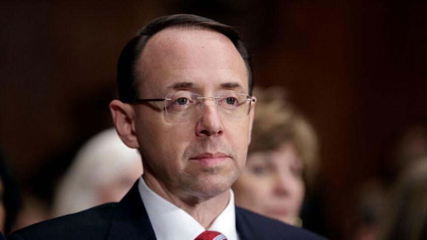FILE- In this March 7, 2017, file photo, then-Deputy Attorney General-designate Rod Rosenstein, list