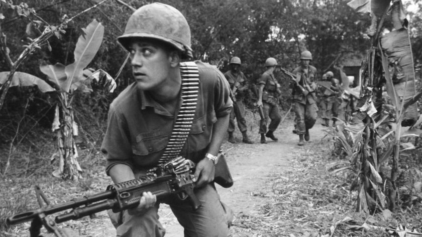 Machine gun at the ready, a paratrooper of the U.S. 82nd Airborne Brigade advances cautiously near
