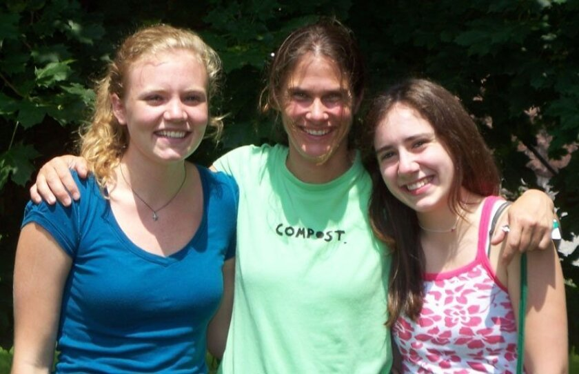 High school biology teacher Karen Smereka with two students during a field research project studying streams in Vermont.
