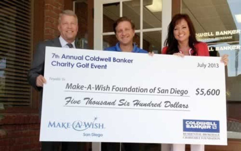 Marty Conrad, senior vice president and general sales manager of Coldwell Banker (Greater San Diego Region), and Chris Sichel, CEO of Make-A-Wish Foundation of San Diego, with Tamie Lizura, executive assistant to Conrad.