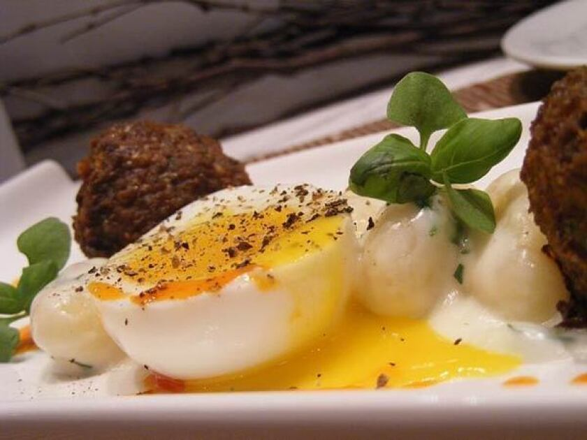 Duck egg, meatballs and gnocchi dish
