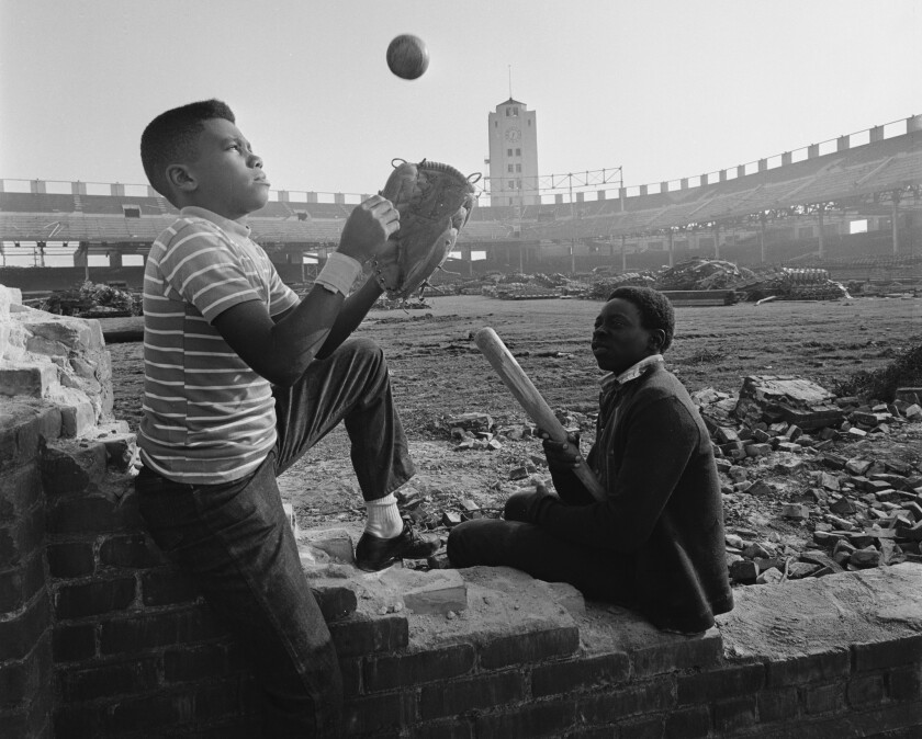Kids play at the original Wrigley Field in Los Angeles, during the days it was being dismantled in March 1969.