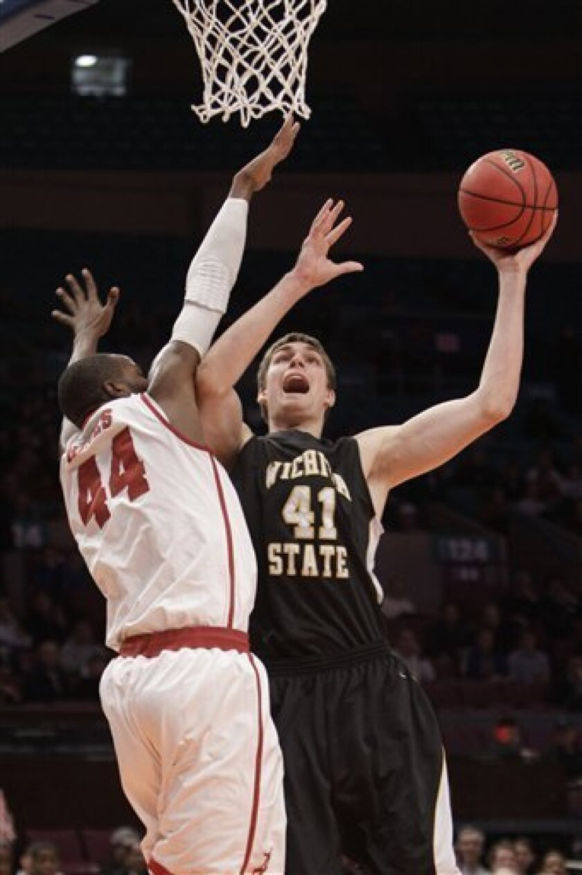 Wichita State's Garrett Stutz (41) goes up against Alabama's Chris Hines (44) during the first half of the championship game of the men's NIT college basketball tournament Thursday, March 31, 2011, at Madison Square Garden in New York (AP Photo/Mary Altaffer)