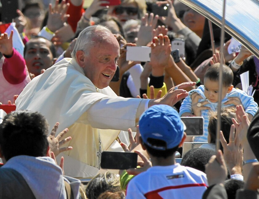 Pope Francis greets people on July 9 after a Mass at the Christ the Redeemer Park, in Santa Cruz, Bolivia.